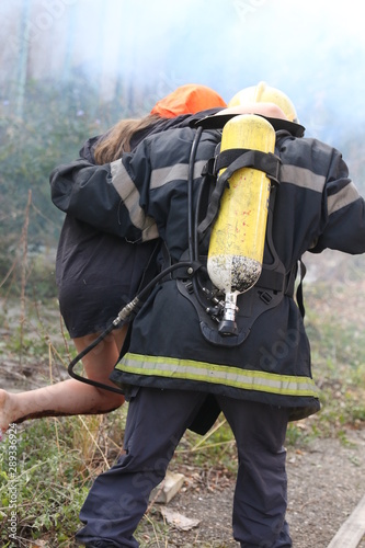 Obraz na plátně  Sofia, Bulgaria - September 12, 2019: Volunteers from the organization of the Bulgarian Red Cross participate in training with a fire service