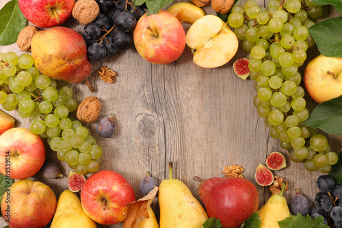autum fruit composition, grapes with apples, walnut, fig and pear Fotobehang