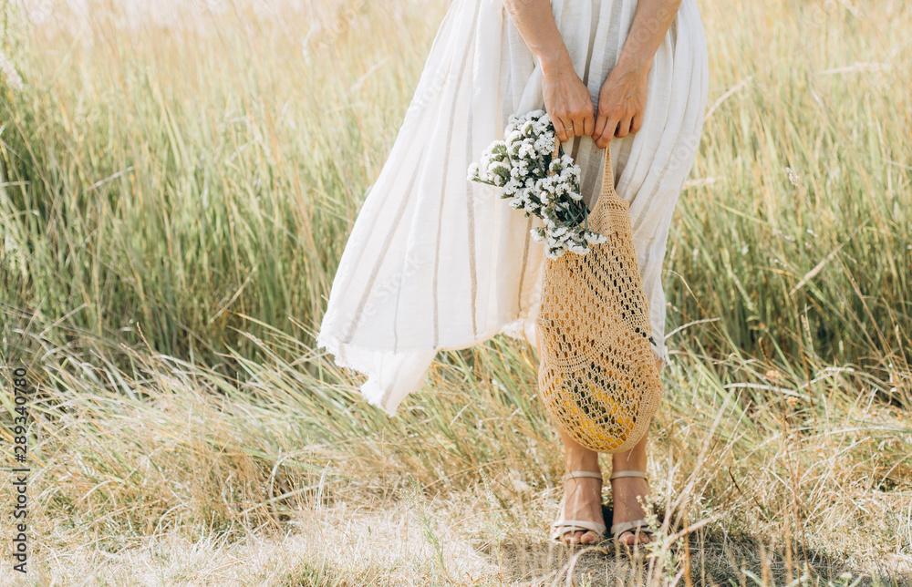 Fototapeta woman natural clothes eco mesh string bag wildflowers