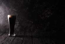 Glass Of Dark Beer On Wooden T...