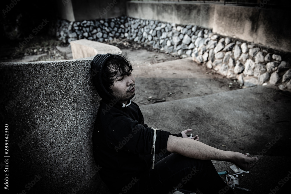 Fototapety, obrazy: Asian man wear black hood desperate drug addict,Drug overdose and the shocked unconscious,The drugs cause death,Thailand people,inject heroin to blood vessel