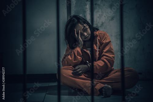 Portrait of women desperate to catch the iron prison,prisoner concept,thailand people,Hope to be free,If the violate the law would be arrested and jailed Tablou Canvas