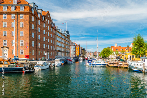 Foto auf Leinwand Dunkelbraun Christianshavn channel with colorful buildings and boats in Copenhagen, Denmark