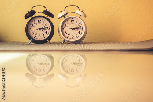 Close up alarm clock with reflection on ground, Vintage