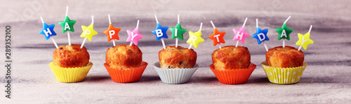 Chocolate muffin and nut muffin with happy birthday candle, homemade bakery on t Canvas Print