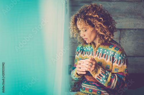 Fotografie, Tablou Lonely cacuasian adult lady at home - people relaxing and taking his own time lo
