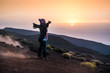 people enjoying open nature at the mountain during sunset -active woman in outdoor leisure activity with open arms - freedom and alternative lifestyle travel concept