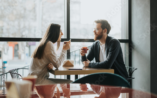 Obraz Multiracial friends talking over coffee - fototapety do salonu