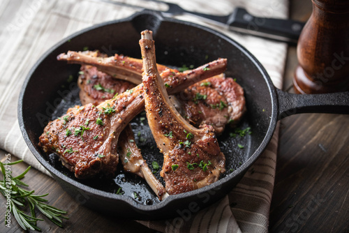 Fototapeta grilled lamb chop on cast iron pan