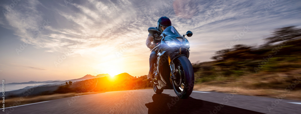 Fototapety, obrazy: motorbike on the coastal road riding. having fun driving the empty highway on a motorcycle tour journey