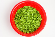 Freeh Organic Green Peas In A Large Red Round Bowl Isolated On White, Top View