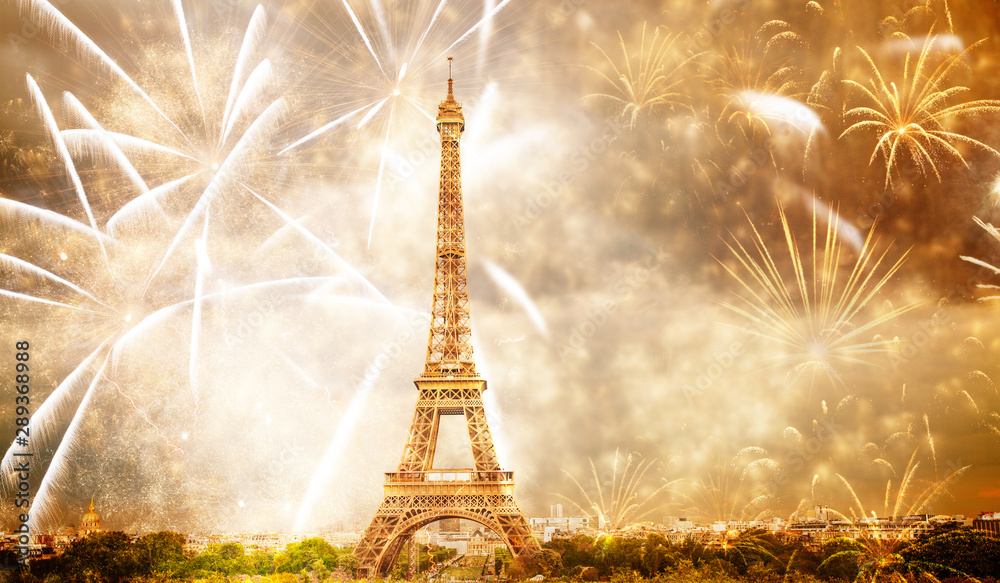 celebrating the New Year in Paris Eiffel tower with fireworks