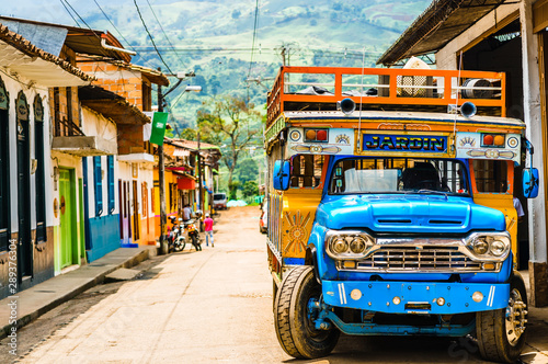 Obraz View on Typical colorful chicken bus near Jerico Antioquia, Colombia, South America - fototapety do salonu