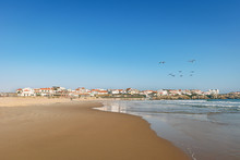View To Surfer Beach Praia Do Lagido And Island Baleal With Fishing Village In Summer, Peniche Portugal
