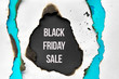 """canvas print picture Text """"Black Friday Sale"""" in burnt hole in white and turquoise paper with burned edges"""