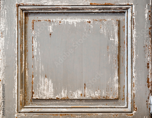 Distressed painted wood panel from a shutter or inlaid wall. Chipped paint on distressed wood surface.