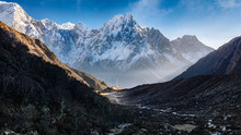 Snow Covered Mountain Peaks In Himalayas And Valley Village,  Nepal.