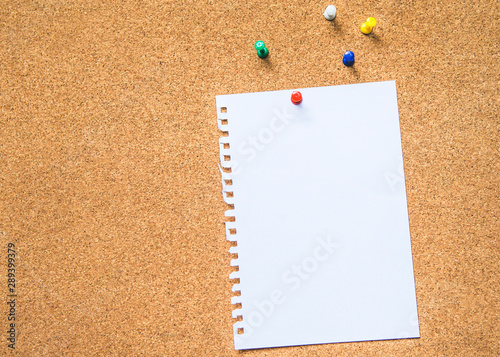 Photo One of white paper pin on brown cock board for text background