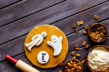 Cooking Halloween Cookies In Shape Of Spooky Figures, Rollin Pin, Nuts And Flour On Wooden Background Top View Mockup