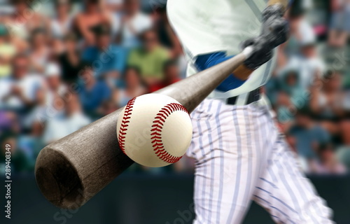 Tableau sur Toile Baseball player hitting ball with bat in close up