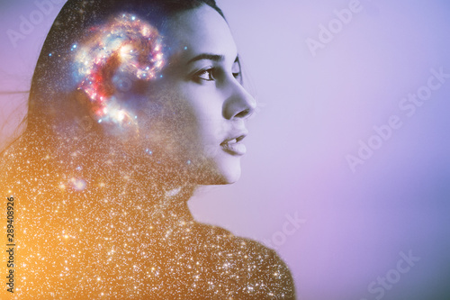 Obraz Double multiply exposure abstract portrait of a dreamy cute young woman face with galaxy universe space inside head. Human spirit, astronomy, life zen concept Elements of this image furnished by NASA. - fototapety do salonu