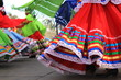 Leinwanddruck Bild - Colorful skirts fly during traditional Mexican dancing