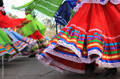 Fényképezés Colorful skirts fly during traditional Mexican dancing