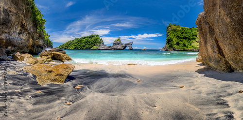 Panoramic view of idyllic tropical beach with small island and perfect azure clean water