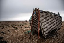 An Abandoned Fishing Boat On Dungeness Beach