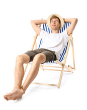 Young Man Relaxing On Sun Lounger Against White Background