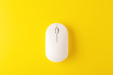 Wireless Mouse On Yellow Backg...