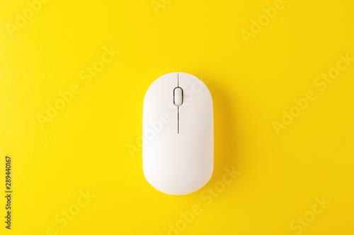 Fotografie, Obraz  Wireless mouse on yellow background