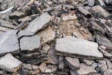 Old Cracked Asphalt In The Pile