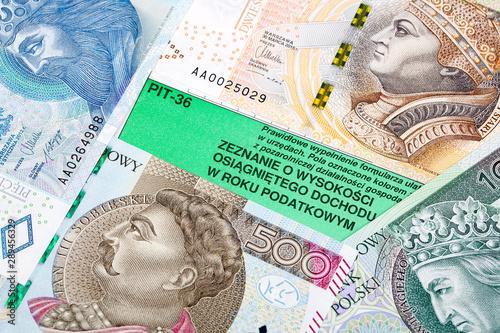 Obraz na plátně  Polish tax information on a background of banknotes