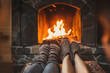 canvas print picture - Couple in wool socks warming by cozy fire. Romantic winter evening