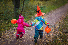 Little Girls Run To Trick Or T...