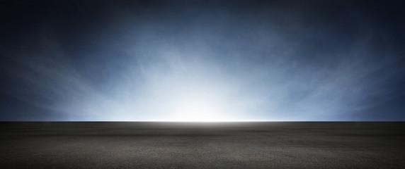 Dark Concrete Floor Background with Dramatic Atmospheric Sky