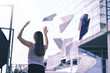 canvas print picture - Business woman throwing work papers in the air. Stress from workload. Person going home or leaving for vacation. Employee got fired. Job or project done. Difficult workday over. Outside of office.