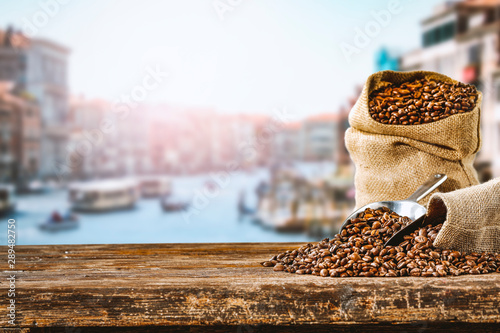 Cafe Fresh hot italy coffee and blurred background of city