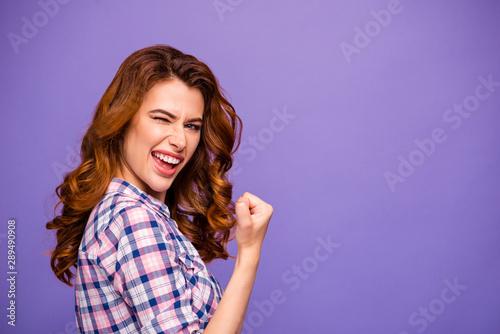 Photo Photo of pretty foxy lady champion winking eye raising fist well done job wear p