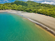 Aerial Drone Image Of The Empty But Beautiful Beaches Around The Gulf Of Nicoya In Costa Rica With Two Small Tourist Boats Near The Waters Edge