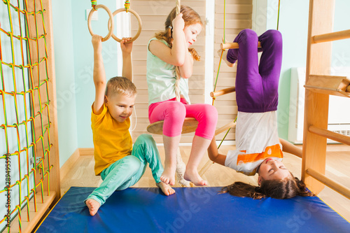 Poster Fitness Children playing together in home kids gym
