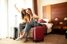 Traveling Girls Resting In A H...