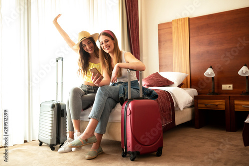 Traveling girls resting in a hotel room