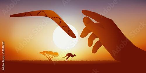 Concept de l'agilité, avec le bras d'un arborigène qui lance un boomerang dans un paysage désertique australien où cours un kangourou Wallpaper Mural