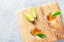 Golden Tequila Shots With Lime Slices And Salt Rims, Shot From The Top With Copyspace