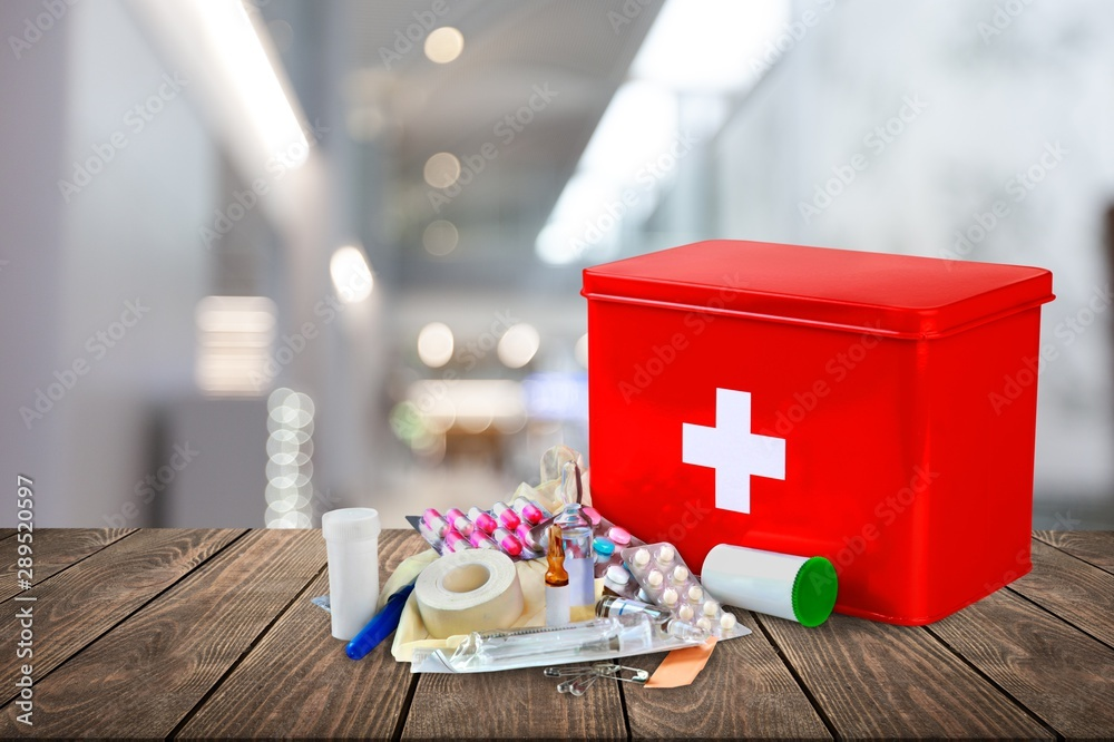 Fototapety, obrazy: First aid kit  with medical supplies on light background
