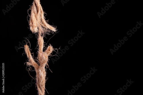 Obraz frayed rope ready to break on black background - fototapety do salonu