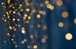 canvas print picture holiday, illumination and decoration concept - bokeh of christmas garland lights over dark blue background