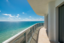 View From A Condominium Balcony Showing The Beach And Ocean